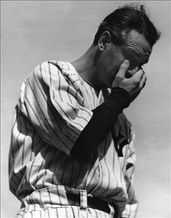 New York Yankees' Lou Gehrig wipes away a tear during a sold-out tribute at Yankee Stadium on July 4, 1939.