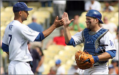 Dodgers catcher Russell Martin, right, will step foot onto the Yankee Stadium infield for Tuesday's All-Star Game. Dodgers manager and former Yankees manager, Joe Torre, told Martin to check out Monument Park while he was at the legendary park.