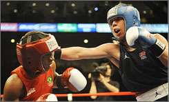 Luis Yanez, right, competes in a bout in May this year. Yanez is appealing to be reinstated to the U.S. Olympic team.