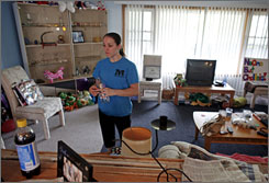 Chellsie Memmel, 20, returns to her Milwaukee home after practice. The gymnast is older than some of her teammates and takes pride in the fact that she's a homeowner.