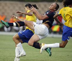 U.S National Womens Soccer Team forward Abby Wambach (center) goes airborne after colliding with Brazil defender Andreia Rosa Wednesday in an exhibition soccer match at Torero Stadium at the University of San Diego. Wambach broke her leg on the play.