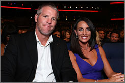 Brett Favre, who appeared at the ESPYs on Wednesday with his wife, Deanna, is expected at the Packers' Hall of Fame ceremony on Saturday.