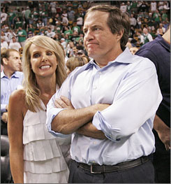 Bill Belichick, with girlfriend Linda Holliday, watched the Boston Celtics win the NBA title more than four months after his New England Patriots lost their bid for an undefeated season in Super Bowl XLII.