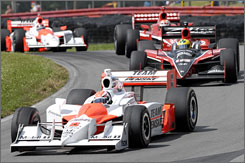 Ryan Briscoe sets the pace ahead of Bruno Junqueira, Scott Dixon and Helio Castroneves at Mid-Ohio Sports Car Course.