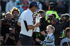 Padraig Harrington greets son Patrick after claiming the 2008 British Open title.