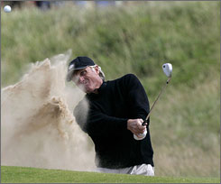 Greg Norman did not hang onto his lead at the British Open but he did receive an offer to play in the Masters.