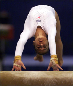 Dominique Moceanu competes for the USA in a 1998 event. In an episode of HBO's Real Sports to be shown Tuesday, the former gold medalist says U.S. coaches Bela and Martha Karolyi could have a better approach.