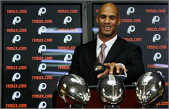 """Jason Taylor said his departure from the Miami Dolphins was amicable. """"I think people are a little disappointed in that,"""" he said. """"I think they want strife or some bickering back or forth, and that's just not what it is."""""""