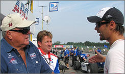 Car owner A.J. Foyt (from left), engineer Mike Colliver and driver Darren Manning talk shop on pit road at Mid-Ohio.