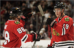Patrick Kane, left, and Jonathan Toews celebrate a goal against the Columbus Blue Jackets. Kane and Toews have helped generate excitement among Chicago Blackhawk fans, who have nearly tripled their number of season tickets sold since the start of 2006-07.