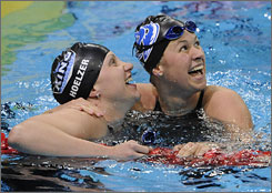 Margaret Hoelzer, left, and Elizabeth Beisel celebrate Hoelzer's world record time at the Olympic trials in Omaha earlier in July.