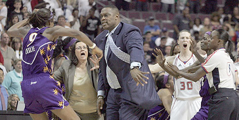 Detroit assistant coach Rick Mahorn, center, pushes down Lisa Leslie during their WNBA game on Tuesday. The referees ejected Mahorn, who was trying to keep Leslie from approaching the Shock bench.