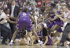 Detroit's Plenette Pierson, bottom left, scuffles with Candace Parker in the closing seconds of their WNBA game in Auburn Hills, Mich. Pierson and Parker were among four ejections dished out.