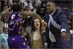 Shock assistant coach Rick Mahorn brushes Lisa Leslie aside in Tuesday night's late-game altercation.
