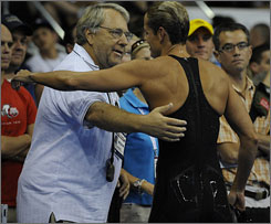 Coach Michael Lohberg gives Dara Torres a hug after her semifinal heat during the U.S. Olympic swim trials in Omaha on July 3.