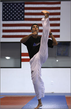 Steven Lopez works out in preparation for the Olympics at his training complex in Sugar Land, Texas.