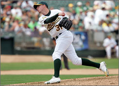 Athletics reliever Brad Ziegler works against the Rangers on Sunday, setting a record for scoreless innings to start a career.