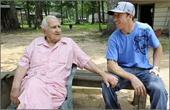Kyle Bennett, right, hangs out with his grandfather, Don Collins, at Collins' home in Texas. Bennett is a 3-time world champion and should contend for a BMX medal in Beijing.