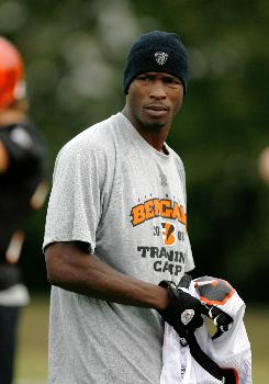 An injured Chad Johnson watches practice during training camp at the Georgetown College in Georgetown, KY.