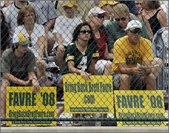 Packers fans display their preference for Brett Favre at practice on Tuesday.