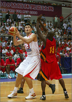 Yao Ming drives to the basket for two of his 21 points in Tuesday's victory over Angola in the FIBA Diamond Ball tournament in Nanjing.