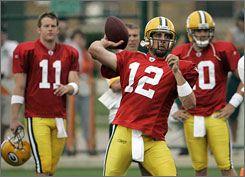 If Brett Favre doesn't return, the Packers plan to enter the season with Aarod Rodgers, center, as the starting quarterback and Brian Brohm, left, and Matt Flynn as his backups. None of the three has ever started a game.