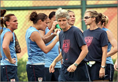 Coach Pia Sundhage directs the U.S. women's soccer team during a workout in China on July 28.