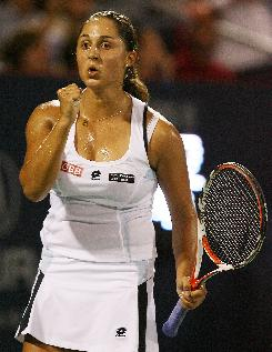 Austria's Tamira Paszek celebrates after winning a game against Ana Ivanovic, the No. 1 player in the world, Thursday in the Rogers Cup in Montreal. Paszek defeated Ivanovic 6-2, 1-6, 6-2.