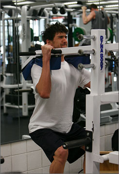Phelps lifts weights at the Olympic Training Center in Colorado Springs in January. Lifting has helped improve his turns.