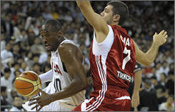 Kobe Bryant drives around Turkey's Keren Tunceri during the United States' victory in an Olympic tuneup.