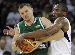 Kobe Bryant challenges Lithuania's Rimantas Siskauskas for the ball during Team USA's win on Friday.