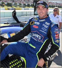 Jimmie Johnson climbs out of his car after winning his third pole of the season at Pocono Raceway. Johnson is fourth in the Sprint Cup points standings.
