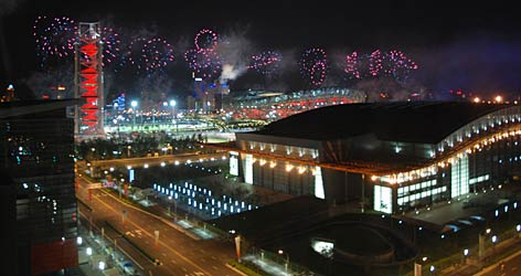 "Fireworks light up the Beijing night sky during an Opening Ceremonies rehearsal. The test run came against the backdrop of the National Stadium (or ""Bird's Nest""), in the distance behind the National Indoor Stadium."