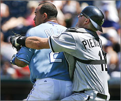 White Sox catcher A.J. Pierzynski restrains the Royals' Miguel Olivo during a fifth-inning brawl.