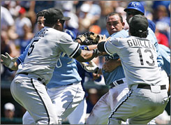 White Sox manager Ozzie Guillen rushes out onto the field to break up a fight involving the Royals' Miguel Olivo, third from right. Olivo and teammate Zack Greinke were suspended five games, while Guillen was suspended for two.