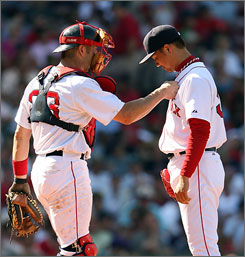 Red Sox catcher Jason Varitek encourages reliever Hideki Okajima after another rough outing. An inconsistent bullpen is one cause for concern for manager Terry Francona down the stretch.