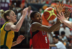 U.S. and Los Angeles Sparks center Lisa Leslie, right, vies for the ball with Australia's Lauren Jackson, forward for the Seattle Storm, during their final pre-Olympic game Tuesday at the FIBA Diamond Ball tournament. The U.S. beat Australia 71-67.