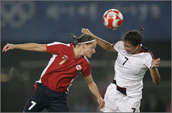 USA's Shannon Boxx, right, battles for the ball with Norway's Trine Roenning during their Olympic Group G match in Qinhuangdao.