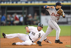 Detroit's Placido Polanco, right, throws to first base after forcing out the Chicago White Sox's Carlos Quentin (20) at second base during the first inning of Wednesday's game. The White Sox beat the Tigers 5-1.