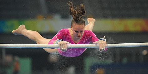 Wisconsin's Chellsie Memmel practices on the uneven bars, the only Olympic event the 20-year-old is expected to compete in. A sprained right ankle suffered last weekend has put a dent in her hopes at the Beijing Games.