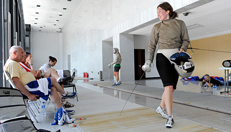 Becca Ward looks back at her coach in expectation of scoring a point during practice for the Summer Games at the Beijing Normal University.