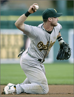 Oakland Athletics third baseman Jack Hannahan throws to second to start a double play after fielding a grounder hit by the Detroit Tigers' Gary Sheffield in the fourth inning Friday. The A's beat the Tigers 4-2 to win for the first time since July 27.