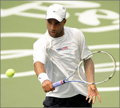 U.S. tennis player James Blake returns the ball during a training session ahead of the Beijing 2008 Olympic Games.