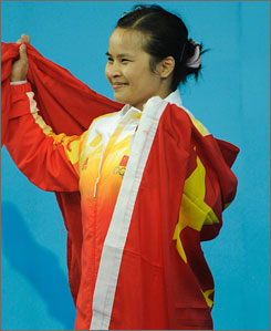 Chen Xiexia of China won the host's first gold medal of the Olympics in the women's weightlifting competition Saturday.