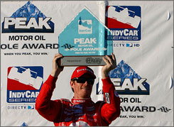 Scott Dixon, IndyCar Series points leader, celebrates his pole position for the Meijer Indy 300 Friday at Kentucky Speedway in Sparta, Ky.