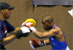 American boxer Gary Russell Jr. collapsed during a workout in China as he tried to reach his fighting weight for the 119-pound class.