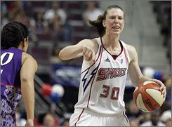 Detroit Shock's Katie Smith looks for a teammate during a WNBA basketball game in July. Smith hopes to make the same tireless, all-around contributions to her Olympic team that have helped make her a six-time WNBA all-star.