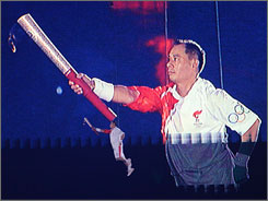 Li Ning, the final Olympic Torch Runner, lights the flame.