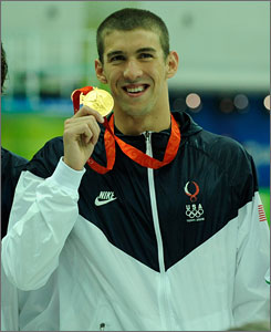 Michael Phelps poses with his first gold medal of the Beijing Games. Phelps is chasing Mark Spitz's record of seven golds in a single Olympics.