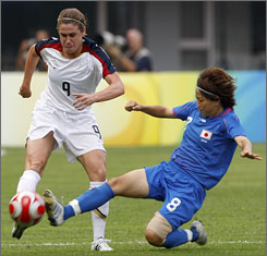 Japan's Aye Miyama, right, battles for the ball with Heather O'Reilly of the U.S. at the second round soccer match in Qinhuangdao, China, Saturday.